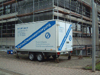 ETRAS trailer in front of scaffolding